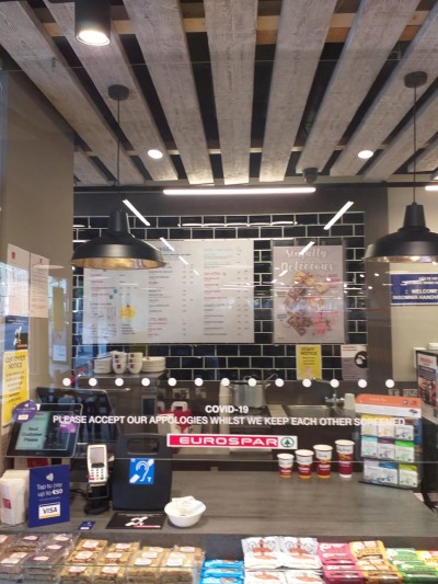 COVID-19 Protective Screen in a Dublin Supermarket - transparent protective Perspex / acrylic screens for shops, retail outlets, bars, offices etc - supplied and fitted by McDara Homes, Ireland